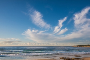 Spindrift clouds over the beach