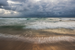Shiny water seascape with stormy clouds