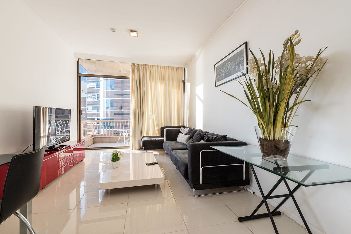 Living room with plant and modern city view