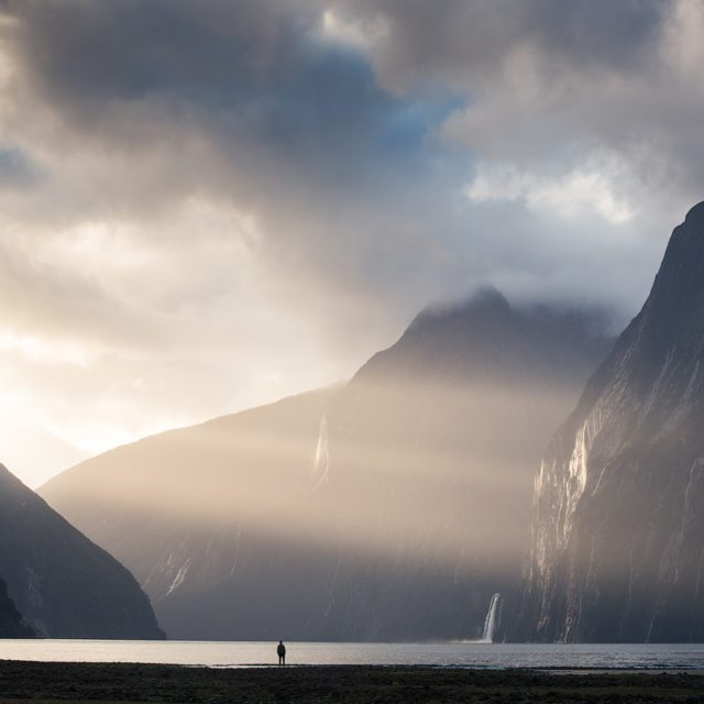 Milford Sound Sun Rays and a person