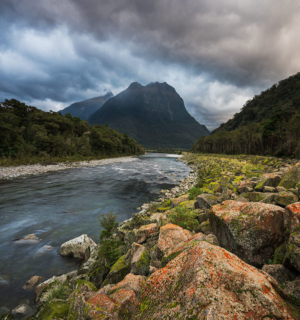 Cloudy mountain landscape with river Milford Sound