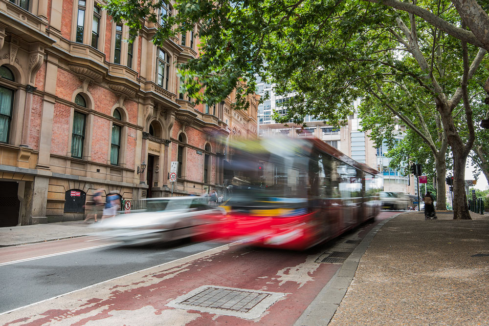 Blurred red bus in sydney