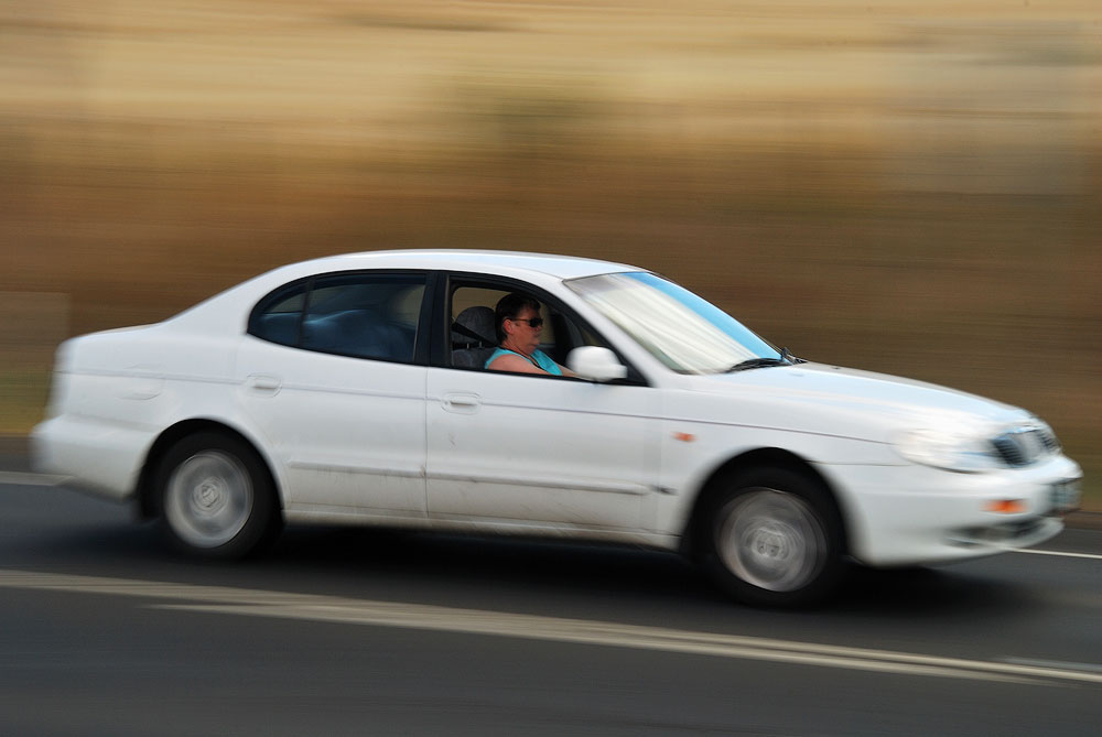 panning moving car