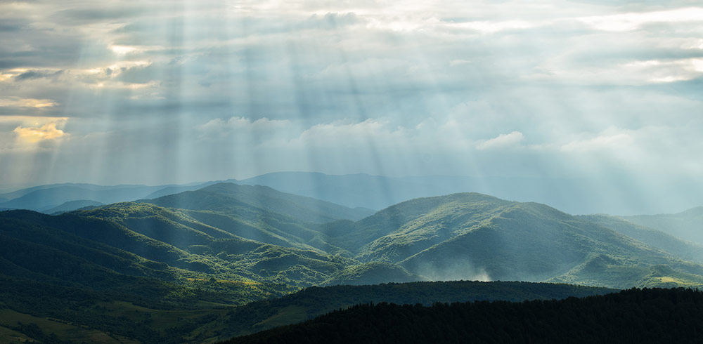 crepuscular rays mountains
