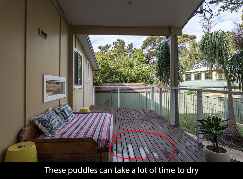 outdoors with hose puddles